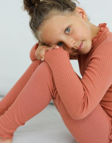 T-shirt à manches longues et bords volantés en laine mérinos pour enfant